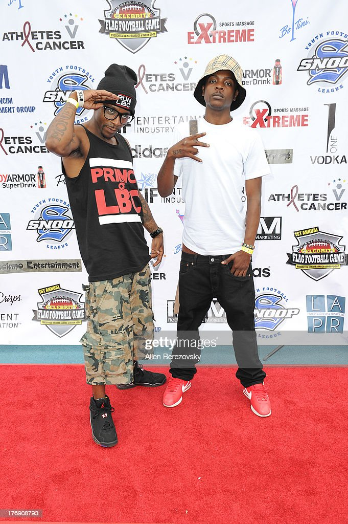 Rappers Prince of Long Beach (L) and Pilot attend the 1st Annual Athletes VS Cancer Celebrity Flag Football Game on August 18, 2013 in Pacific Palisades, California.
