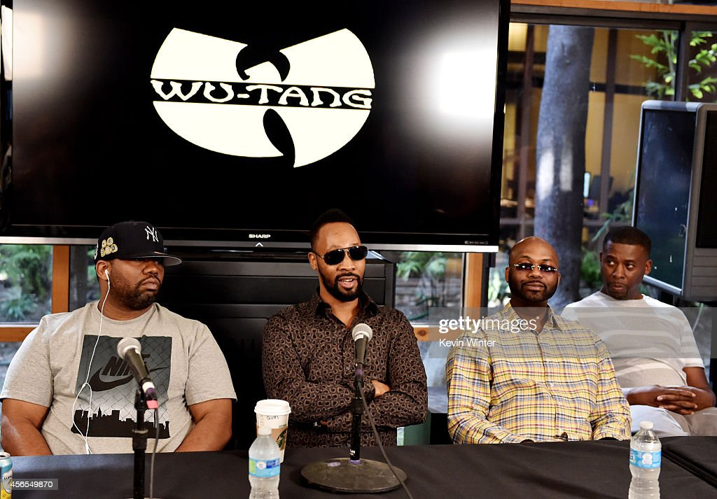 Rappers Raekwon; RZA, Masta Killa and GZA of the Wu-Tang Clan pose at a press conference to announce they have signed with Warner Bros. Records at Warner Bros. Records on October 2, 2014 in Burbank, California.