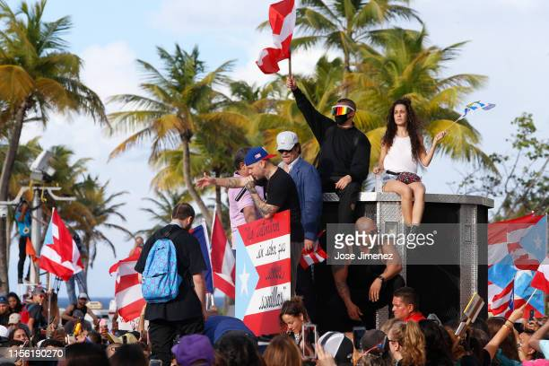 Rappers Residente Bad Bunny and actor Benicio del Toro join thousands of demonstrators protesting against Ricardo Rossello the Governor of Puerto...