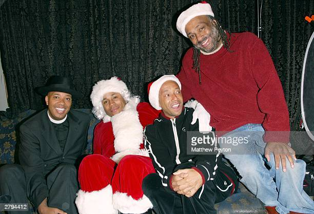 Rappers Reverend Run and LL Cool J and Run's brothers Rush Philanthropic founder Russell Simmons and Danny Simmons who heads Rush wait to celebrate...