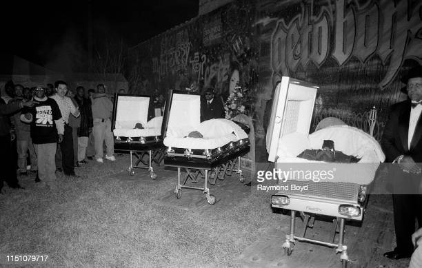 Rappers Scarface Bushwick Bill and Willie D from The Geto Boys are laid out in caskets to promote their cd 'The Ressurrection' at George's Music Room...