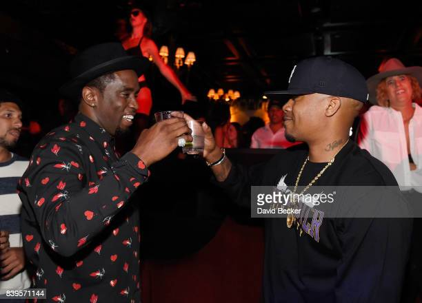 Rappers Sean 'Diddy' Combs and Nas attend the Double or Nothing welcome to fight weekend kickoff powered by CIROC Vodka and AQUAhydrate at the Lavo...