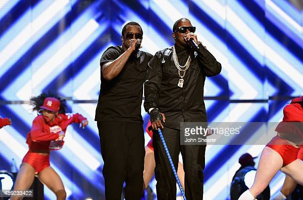 Rappers Sean 'Puff Daddy' Combs and Mase perform onstage at the 2015 iHeartRadio Music Festival at MGM Grand Garden Arena on September 19 2015 in Las...