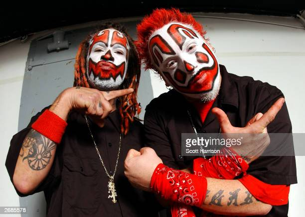 Rappers Shaggy 2 Dope and Violent J of the Insane Clown Posse pose backstage October 30 2003 at the Riviera in Chicago Illinois
