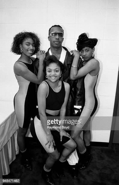 Rappers Sweet LD Lil P and Terrible T from Oaktown's 357 poses for photos with MC Hammer prior to their concert at the Indiana Convention Center in...