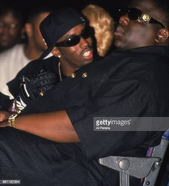 Rappers The Notorious BIG aka Biggie Smalls and Puff Daddy take in Dr Dre's performance at the second Source Awards at the Palladium on August 3 1995...