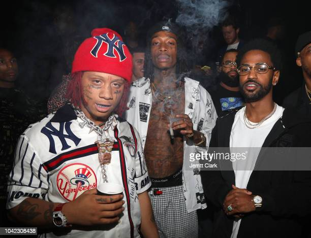 Rappers Trippie Redd Wiz Khalifa and Big Sean attend Lil Wayne's 36th birthday party and Carter V release at HUBBLE on September 27 2018 in Los...