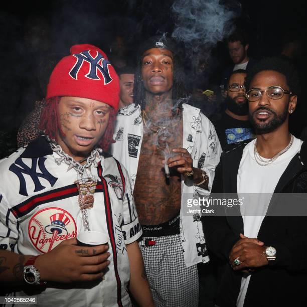 Retransmission with alternate crop LOS ANGELES CA SEPTEMBER 27 Rappers Trippie Redd Wiz Khalifa and Big Sean attend Lil Wayne's 36th birthday party...