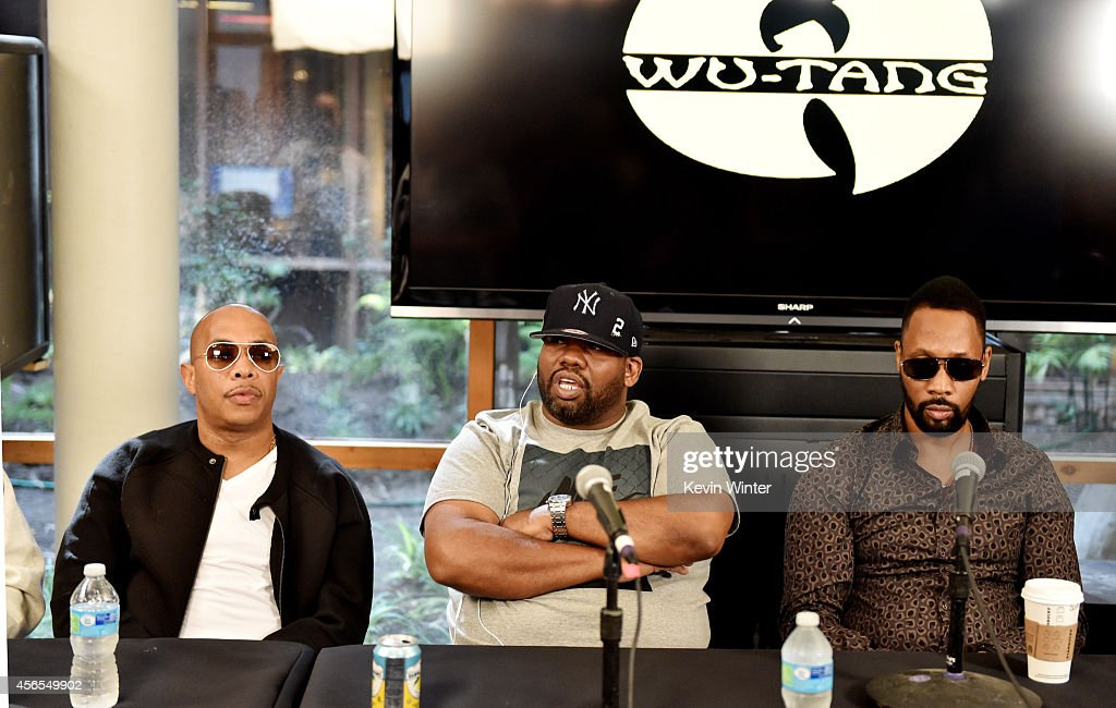 Rappers U-God, Raekwon and RZA of the Wu-Tang Clan pose at a press conference to announce they have signed with Warner Bros. Records at Warner Bros. Records on October 2, 2014 in Burbank, California.