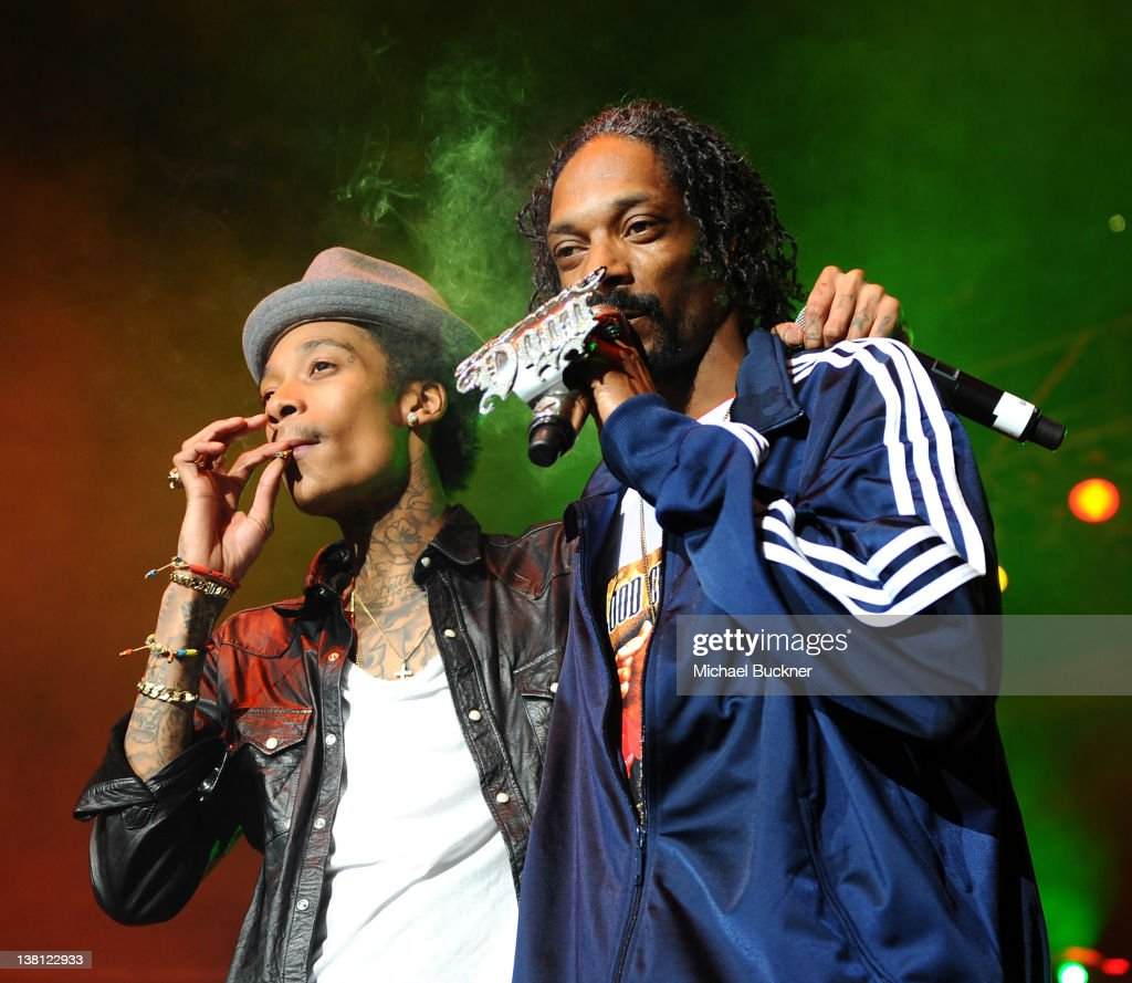 Rappers Wiz Khalifa L And Snoop Dogg Perform On Stage At Bankers Life Fieldhouse