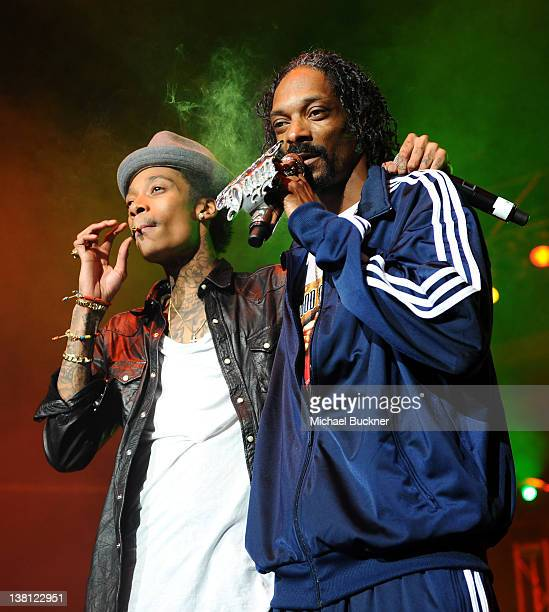 Rappers Wiz Khalifa and Snoop Dogg perform on stage at Bankers Life Fieldhouse on February 2 2012 in Indianapolis Indiana
