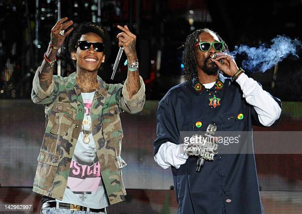 Rappers Wiz Khalifa and Snoop Dogg perform onstage during day 3 of the 2012 Coachella Valley Music Arts Festival at the Empire Polo Field on April 15...