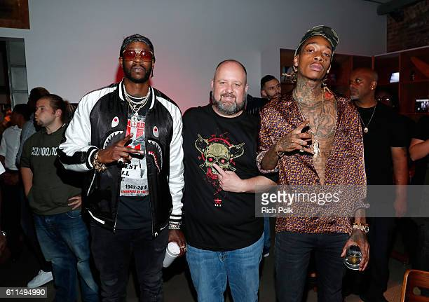 Rappers Wiz Khalifa right and 2 Chainz left and Aaron Greenberg General Manager Xbox Games Marketing attend the Nas Todd Gurley and LA Rams Host Xbox...