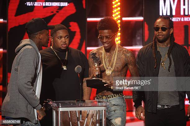 Rappers YG DJ Mustard Rich Homie Quan and Ty Dollar $ign appear onstage during the BET Hip Hop Awards 2014 at Boisfeuillet Jones Atlanta Civic Center...