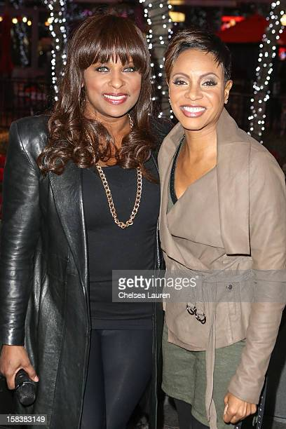 Rappers YoYo and MC Lyte attend AEG's season of giving honoring YoYo School of Hip Hop at Nokia Plaza LA LIVE on December 14 2012 in Los Angeles...