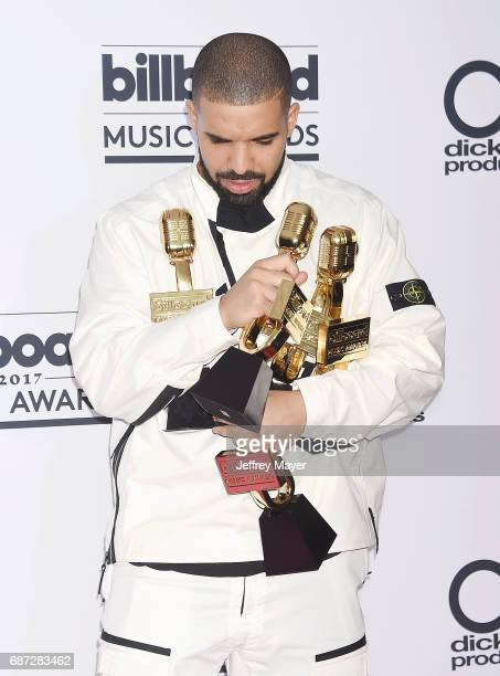 Rappersingersongwriter Drake poses with awards at the 2017 Billboard Music Awards at TMobile Arena on May 21 2017 in Las Vegas Nevada