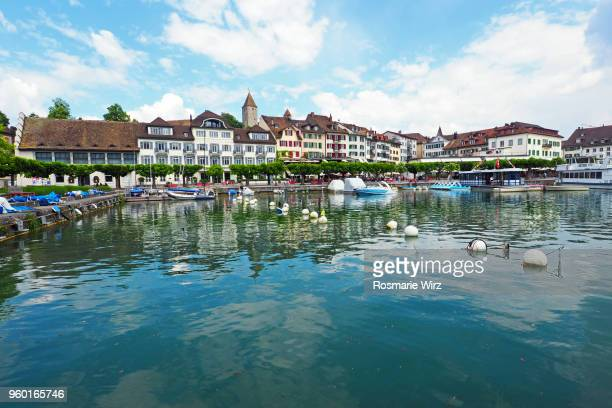 Rapperswil old town with tree-line lake promenade.