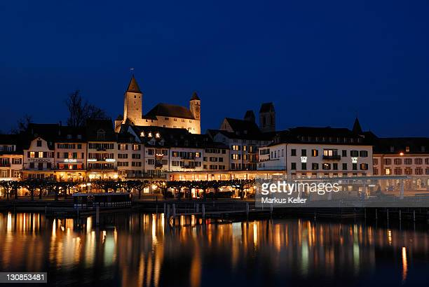 Rapperswil - the promenade and the Rapperswil castle at night - Canton of St. Gallen, Switzerland, Europe.