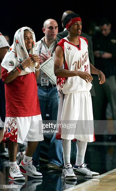 Rapper/west coast player Bow Wow and actor/west coast player Nick Cannon on the sidelines during the McDonald's NBA AllStar Celebrity Game presented...