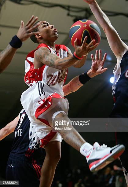 Rapper/west team player Bow Wow drives to the basket against the East during the McDonald's NBA AllStar Celebrity Game presented by 2K Sports held at...