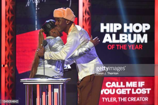 Rapsody presents an award to Tyler the Creator onstage during the 2021 BET Hip Hop Awards at Cobb Energy Performing Arts Centre on October 01, 2021...