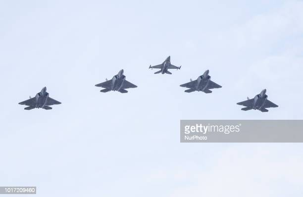 F22 raptor fighters and F16 in the middle durnig military parade in Warsaw on the day of the Polish army 15 August Warsaw Poland