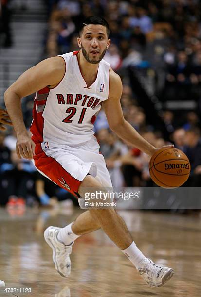 TORONTO MARCH 12 Raptor guard Greivis Vasquez moves the ball around the top of the half court Toronto Raptors vs Detroit Pistons during 2nd half...