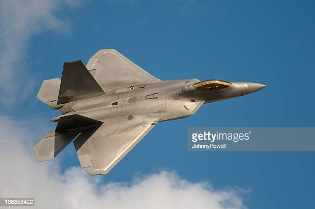 f22 raptor jet fighter flying in the sky - us air force stock pictures, royalty-free photos & images