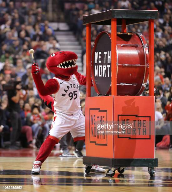 Raptor the mascot of the Toronto Raptors bangs on a drum prior to the start of NBA game action against the Dallas Mavericks at Scotiabank Arena on...