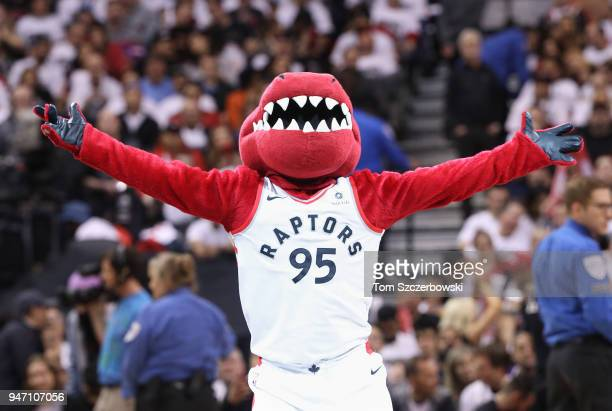 Raptor the mascot of the Toronto Raptors performs during a break in the action of the game against the Washington Wizards during Game One of the...