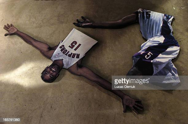 A Raptors Fan Zone display of Vince Carter's arm span lies on the cold hard floor of the ACC tunnel to Union Station A crew from Gempac contractors...