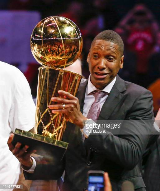 Raptors GM Masai Ujiri hoists the trophy. Toronto Raptors vs Golden State Warriors in 2nd half action of NBA Finals action in Game 6 of playoff play...