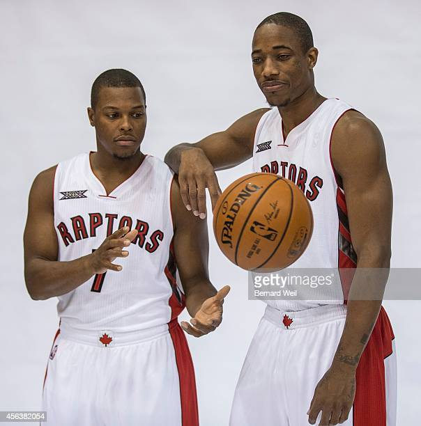 Raptors Kyle Lowry and DeMar DeRozan smile for the cameras during a photo shoot on the team's practise court Players and coaching staff had official...