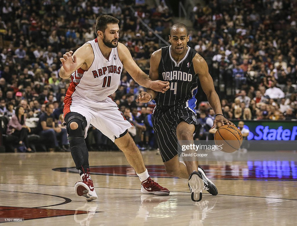 Raptors Linas Kleiza (11) guards Orlando's Arron Afflalo (4) during the game as the Toronto Raptors defeated the Orlando Magic 97-86 at the Air Canada Centre