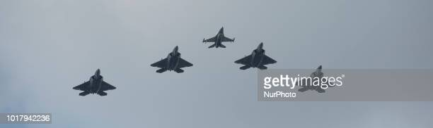 F22 Raptors of the United States Air Force are seen taking part in the Armed Forces Day parade in Warsaw Poland on August 15 2018