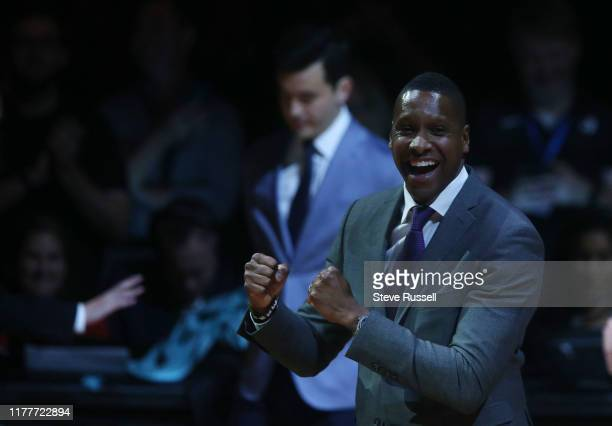 Raptors President Masai Ujiri celebrates on his way to receive his ring as the Toronto Raptors open the season against the New Orleans Pelicans with...