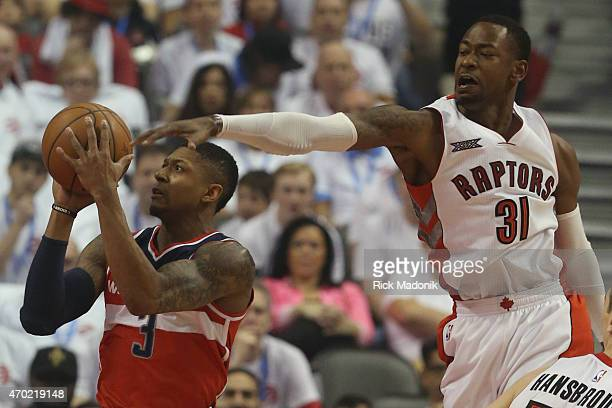 TORONTO APRIL 18 Raptors Terrence Ross gets to the ball from behind as Wizzard's Bradley Beal throws up a shot Toronto Raptors vs Washington Wizzards...