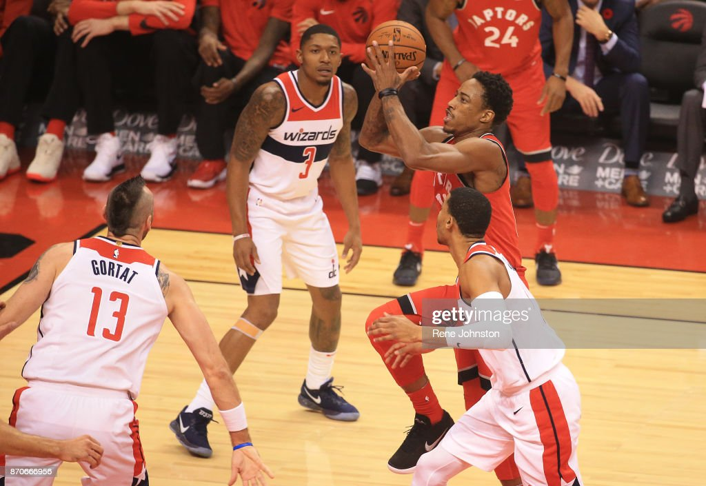 Raptors Wizards . Toronto Raptors DeMar DeRozan goes to the net surrounded by Washington Wizards in NBA action in Toronto Rene Johnston/Toronto Star