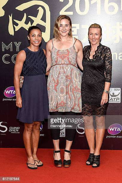 Raquel Atawo and Abigail Spears of the United States arrive with Kveta Peschke of the Czech Republic at the 2016 China Open Player Party at The Birds...
