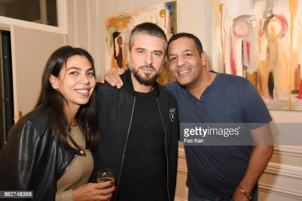 Raquel Dupray Anthony Dupray and comedian Cartouche attend the 'Love EtcÉ' Caroline Faindt Exhibition Preview at '28 Octobre Office' on October 17...