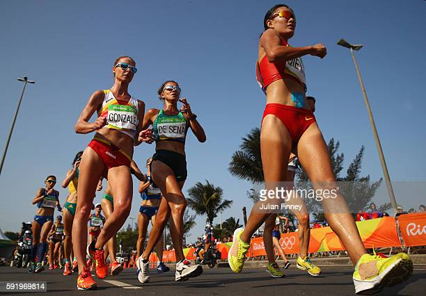 Raquel Gonzalez of Spain, Erica de Sena of Brazil and Shijie Qieyang of China compete in the Women's 20km Walk final on Day 14 of the Rio 2016...