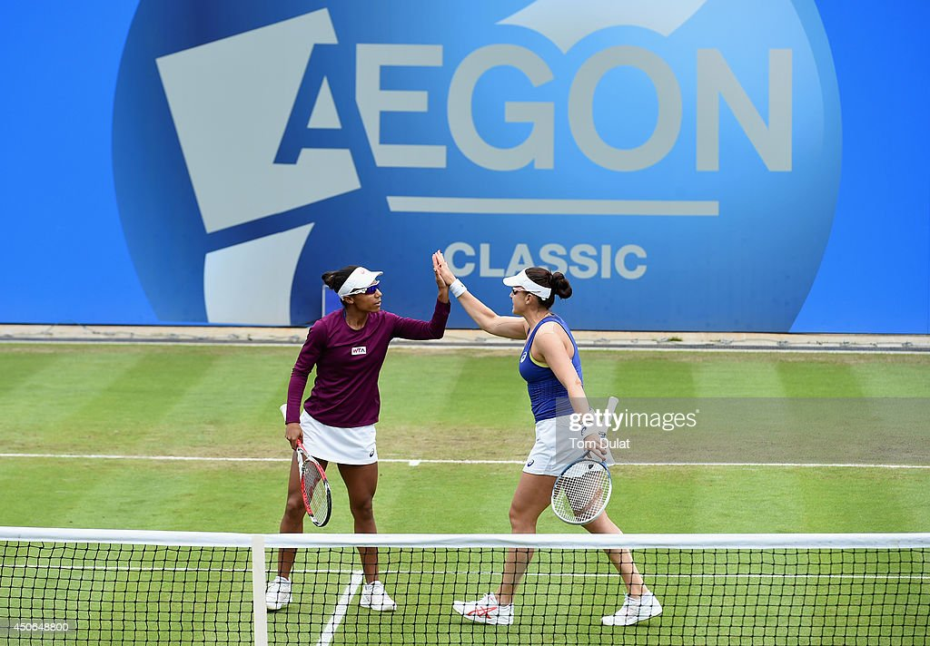 Raquel Kops-Jones and Abigail Spears (R) of the United States celebrate during the Doubles Final during Day Seven of the Aegon Classic at Edgbaston Priory Club on June 15, 2014 in Birmingham, England.