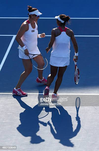 Raquel KopsJones and Abigail Spears of the United States celebrate after winning a point in their first round match against Svetlana Kuznetsova and...