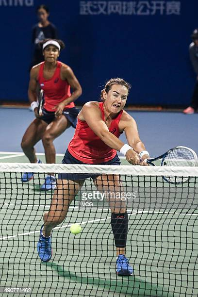 Raquel KopsJones and Abigail Spears of the United States compete against Xinyun Han of China and Nicole Melichar of the United States in Women's...