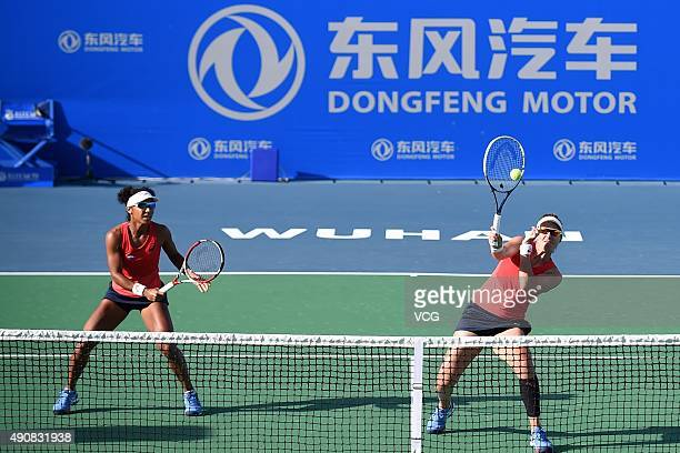 Raquel KopsJones and Abigail Spears of the United States compete against Martina Hingis of Switzerland and Sania Mirza of India in quarterfinals...