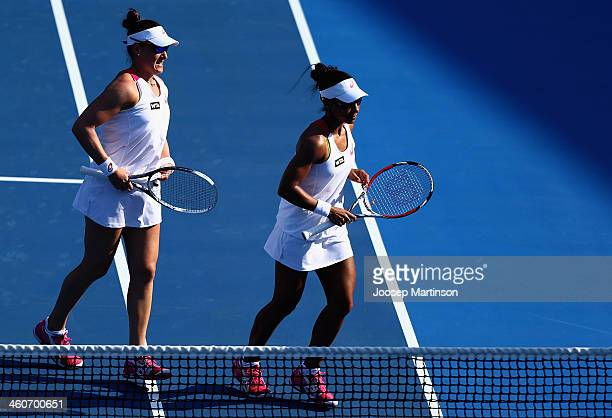 Raquel KopsJones and Abigail Spears of the United States in action in their first round match against Svetlana Kuznetsova and Ekaterina Makarova of...