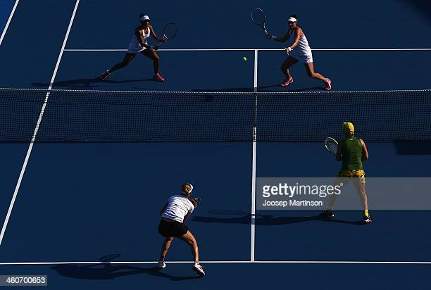 Raquel KopsJones and Abigail Spears of the United States in action against Svetlana Kuznetsova and Ekaterina Makarova of Russia during day one of the...