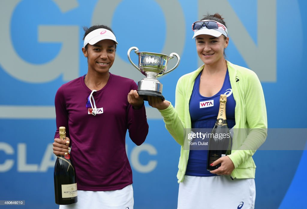 Raquel Kops-Jones and Abigail Spears (R) of the United States pose with the trophy after the Doubles Final during Day Seven of the Aegon Classic at Edgbaston Priory Club on June 15, 2014 in Birmingham, England.