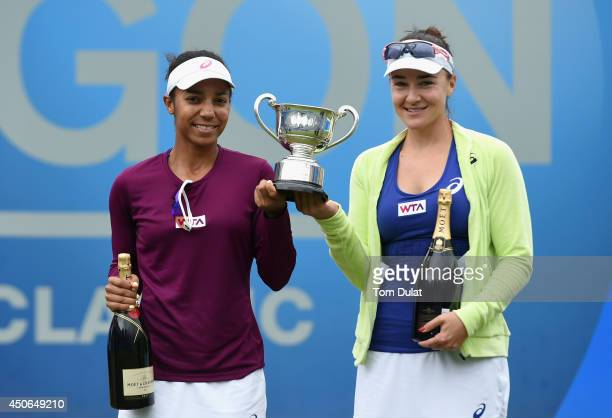 Raquel KopsJones and Abigail Spears of the United States pose with the trophy after the Doubles Final during Day Seven of the Aegon Classic at...