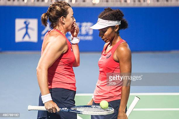 Raquel KopsJones and Abigail Spears of the United States talk in Women's Doubles match against Xinyun Han of China and Nicole Melichar of the United...